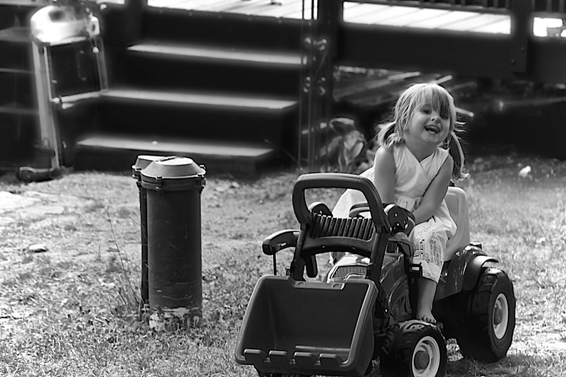 Linewind- As she rides the tractor she can't help but laugh.