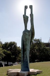 Photo by Bill Jurasz (mercphoto.smugmug.com) in Austin, TX.  6pm CST on June 18, 2005.  From Republic Square Park, looking west into the sun, directly behind this sculpture.