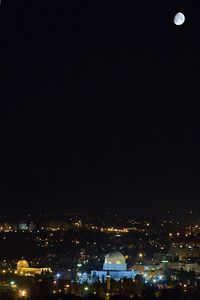 """Photo by Nir Alon.  Taken from Mount Scopus, Jerusalem, Israel, looking SSW at 00:00 local time June 19th 2005   The Mosque of Omar (bottom center), also known as the Dome of the Rock, was built by Caliph Abd-el-Malik in the 7th century on Temple Mount, the site of the Temple of Solomon. The latter was destroyed by the Romans in 70 CE. Regarded by Moslems as the site from which the prophet Muhammad ascended to heaven, and by Jews and Christians as the place where Isaac was nearly sacrificed.   The shrine was covered by a lead dome until it was replaced with a gold-colored covering in 1965. Because of rust, the anodized aluminum cover was again replaced in 1993 with a gold covering.  Middle East politics propose a threat to this location and ancient prophecies of armagedon are related to this site.   In this worldwide project, the Dgrin Worldwide Sky Shoot 2005, I wanted to shoot a location significant to Jerusalem. I chose to shoot from Mount Scopus (31.793N 35.242E), the Eastern most ridge in Jerusalem, bordering the Judean Desert, in order to get the mosque and the moon in the frame. Although the sky was dark at 00:00 local time (21:00GMT) I'm very happy with the result as I feel it screams """"Jerusalem"""".  Taken with Canon 20d with Canon EF 28-105mm f/3.5-4.5 II USM @ 105mm, ISO200. One f/11 2.5s frame processed twice and blended for dynamic range in bottom of photo. Second frame f/11 1/100s shot within seconds for moon exposure and blended in image.  A daylight photo of the mosque   HERE      and a historic view   HERE"""