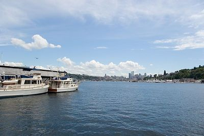 Photo by Mike Lane.  This shot was taken on the north part of Lake Union (N47.65 W122.34) looking south-southeast.  The buildings that are just right of the center of the image are downtown Seattle.  The Space Needle is obscured by the hill (which is the Queen Anne neighborhood).  My camera's time stamp is about 11 seconds slow.
