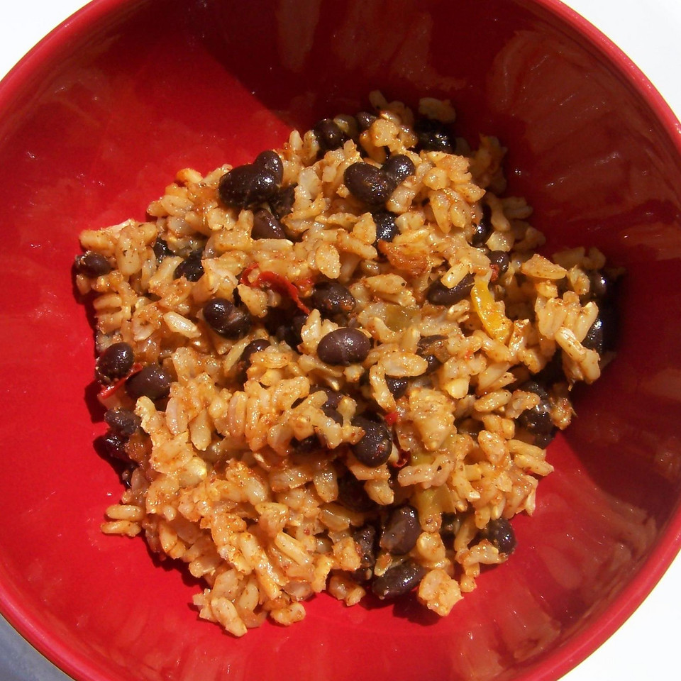 <strong>Ben's Dirty Rice and Beans</strong>  The Recipe: 1 large yellow onion 2 medium red bell peppers 3-5 cloves garlic (to taste) 1/2 teaspoon ground black pepper 1/4-1/2 teaspoon cayenne pepper (to taste) 1-3ish tablespoons taco seasonsing (I highly recommend using more than you think you need) 4 cups vegetable broth 2 cups uncooked brown rice 1 can black beans  Here is the super easy part: - Chop ends off onion, peel, cut in half and toss in Vita-mix - Chop stem off and cut seeds out of bell peppers, toss in with onion - Toss garlic, pepper, cayenne, taco seasoning and vegetable broth in Vita-Mix - ZZZZZZ! (blend it, but on a lower speed so you leave it very slightly chunky, but mostly blended)  -Combine liquid mix with rice in sauce pan. Bring to boil, stir it and lower heat to a low simmer. Cover and cook for 40 minutes, or until rice is done. Take a peek after 25 minutes to make sure you aren't out of moisture (add more broth or water if you need), but avoid opening the lid if you can help it. Check rice at 40 minutes to make sure it is done/tender.  - Open can of beans, rinse and drain. Add to rice, serve.  You may need 2 cans of beans if you want a higher bean to rice ratio.   Super yummy. Enjoy!