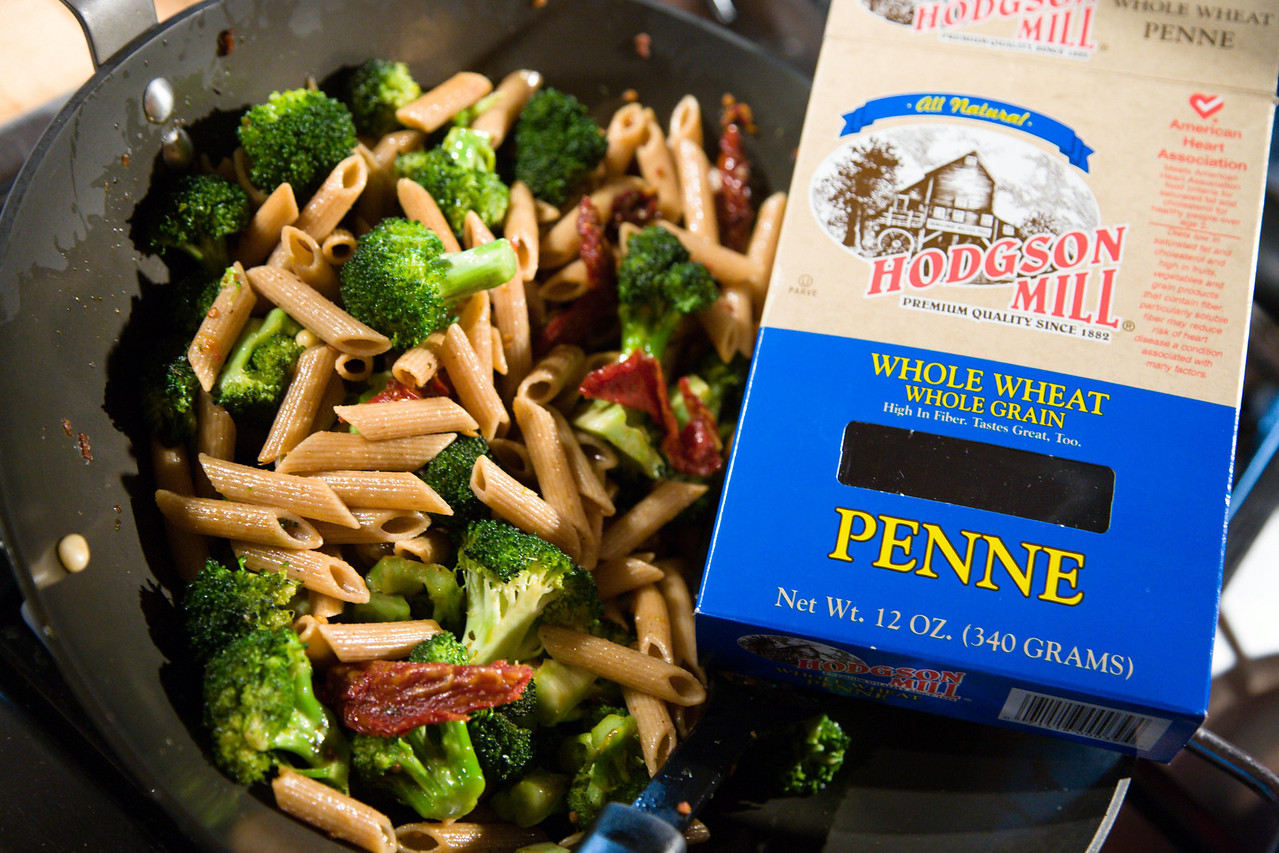 <strong>Penne, Sundried Tomatoes, Broccoli and Pine Nuts</strong> <br> Dead simple easy to make. <br> Ingredients:  Whole wheat, whole grain penne pasta (read the box label!);  1 large head of broccoli (can substitute broccoli rabe, too!); 1 cup sun-dried tomatoes (use fresh tomatoes in season, if you wish!); 1/4 cup pine nuts;  tiny bit of olive oil (use it sparingly!); kosher salt and pepper to taste. <br> <br> Cut the stems off your broccoli.  Get the tomatoes into bite-size pieces. Boil the water for the pasta, and cook the pasta (don't over do it!).  Once you toss the pasta in the water, and it has cooked for a few minutes, it's now time fire up your wok (a skillet will do, too).  A little olve oil (1-2 tbsp) is all you should need.  Toss the tomatoes, pine nuts and broccoli in, and cook over high heat for about 5 minutes or so.  The idea is to have the broccoli al dente (not soft and mushy!).  Cover the veggies while you drain the pasta.  Once drained, toss the pasta in the wok, and then keep cooking just a few minutes longer, just to get the flavors mixed in with the pasta. <br> Eat and enjoy.