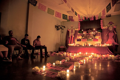 Totus Tuus, a youth group that meets every Friday at Our Lady of Guadalupe Church, holds hands in prayer to close their Dia de Los Muertos celebration on November 3, 2017.    Gabriela Campos/The New Mexican