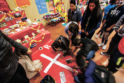 Ninth grade students from Tierra Encantado Charter School  put finishing touches on a alter for Dia de los Muertos remembering the victims of the ear quake in Puerto Rico on Thursday November 2, 2017.  Gabriela Campos/The New Mexican