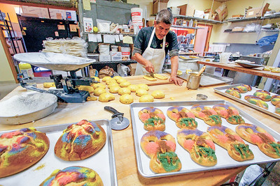 Bakers preparing Pan de Muerto in Santa Fe. Gabriela Campos/The New Mexican