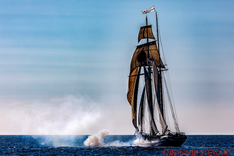 California Sailing ship in full mast shooting a canon.
