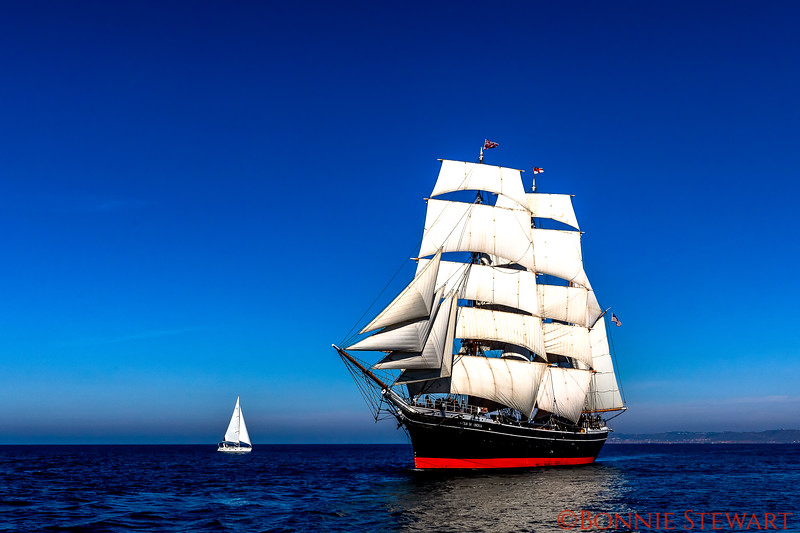 The Star of India with full sails with a sailboat in the distance