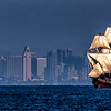 The San Salvador in full sail with the skyline of San Diego in the background.