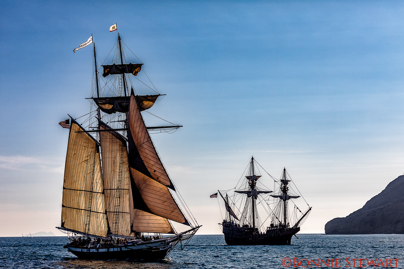 The California with full sails and the San Salvador with no sails getting ready to enter the harbor