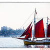 The Escort Boat with red sails