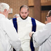 Deacon Stephen Hauck is vested with the stole and dalmatic on April 9. (Photo by Juan Guajardo / NTC)