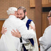 Dcn. Stephen Hauck is embraced after being vested with the stole and dalmatic. (Photo by Juan Guajardo / NTC)