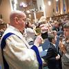 Dcn. John Martin serves Communion during the ordination Mass April 9. (Photo by Juan Guajardo / NTC)
