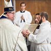 Stephen Hauck promises obedience to Bishop Olson during the promise of the elect. (Photo by Juan Guajardo / NTC)
