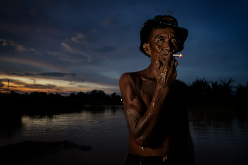 Diamond miner Sanur Basri portrayed after a long day working in the diamond fields.