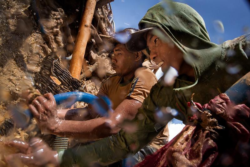 Diamond miners working hard in the diamond fields.