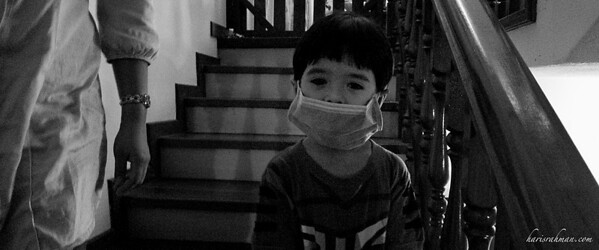 The boy with the mask!  The H1N1 has certainly reached fever pitch. Even Irfan is taking matters to his own little hands.