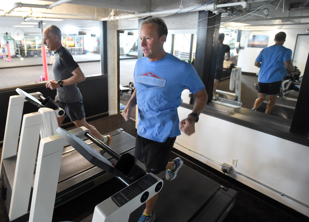. Michael Friess, left, works out with Dick Sumerfield at RallySport Health & Fitness in Boulder, training for the next Ironman. Dick Sumerfield was hospitalized for three days and almost died from dehydration after competing in last year\'s Ironman Boulder.  Cliff Grassmick  Staff Photographer May 19, 2017