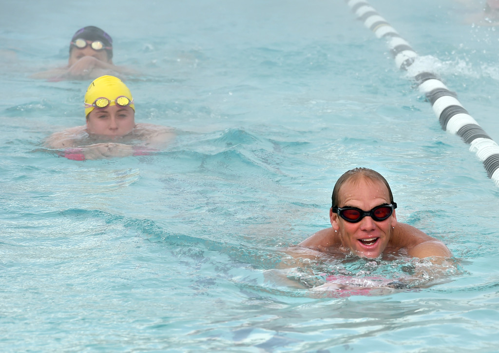 . Dick Sumerfield, right,  works out  in the pool at RallySport Health & Fitness in Boulder, training for the next Ironman. Dick Sumerfield was hospitalized for three days and almost died from dehydration after competing in last year\'s Ironman Boulder.  Cliff Grassmick  Staff Photographer May 19, 2017