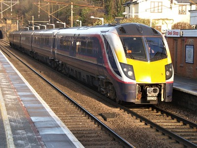 Hull Trains 180102 passing Welwyn North on a Hull-Kings Cross service   13/12/10
