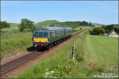 51192/56062 run alongside Sheringham golf course whilst working the 1415 Sheringham-Holt service on 12/06/2014.