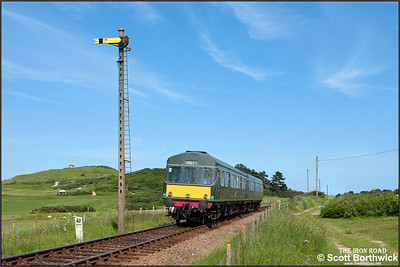 51192/56062 run alongside Sheringham golf course whilst working the 1545 Sheringham-Holt service on 12/06/2014.