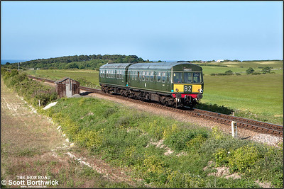 51192/56352 accelerate away from Weybourne whilst working 2C23 1730 Holt-Sheringham on 11/06/2015. (Photo taken with camera mounted on a pole & remotely triggered)
