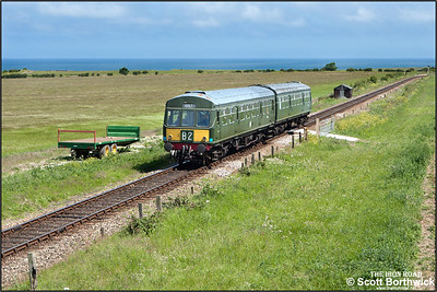 51192/56352 approach Weybourne whilst forming 2M06 1115 Sheringham-Holt on 11/06/2015. (Photo taken with camera mounted on a pole & remotely triggered)