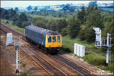 Class 122 'bubble car' 975540 awaits the road at Tupton whilst working a route learning special on 09/06/1992.