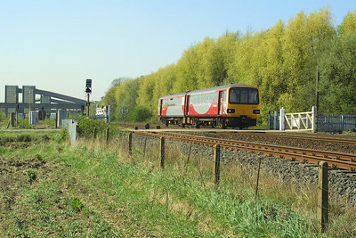 144011 passes Hagg Lane Crossing, Gascoigne Wood on 17/04/2003.