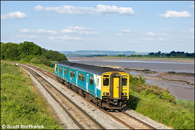 150253 runs alongside the River Severn passing Wellhouse Rock, Purton whilst forming 2L67 1745 Cheltenham Spa-Maesteg on 24/06/2009.