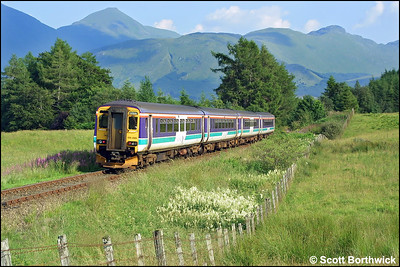 156499 brings up the rear of the 1615 SuO Oban-Glasgow Queen Street service lead by 156485 as they approach Crianlarich on 04/08/2002.