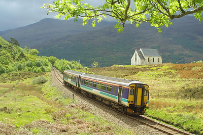 156474 passes the delightful location of Polnish whilst working the 1030 Mallaig-Glasgow Queen Street service on Sunday 18/05/2003.