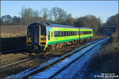 158791 approaches Whitacre Junction with a service for Birmingham New Street on 05/01/2003.