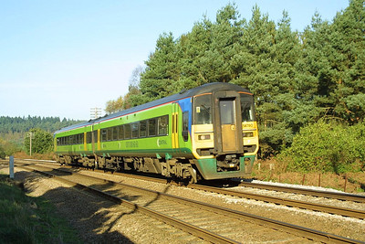 158780 works a Liverpool Lime Street-Norwich service through Thetford Forest at Santon Downham on 03/11/2001.