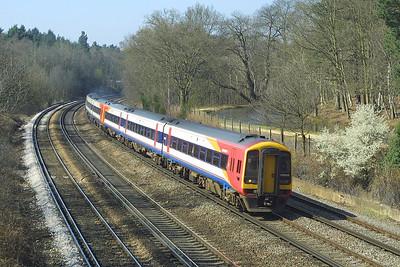 159004+159012 head a London Waterloo bound service near Pirbright Junction on 04/04/2003.