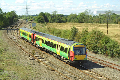 Sporting Robin Hood Line promotional livery, 170513 passes Whitacre Junction on 30/08/2003 whilst working 2E69 1255 Birmingham New Street-Lincoln Central.