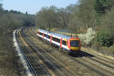 170304 passes Pirbright Junction on 04/04/2003.