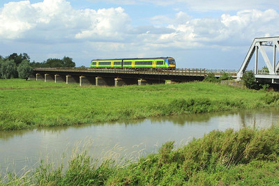 170619 is about to cross the New Bedford River or Hundred Foot Drain near Pymore on 21/08/2004 whilst forming 1L16 1227 Birmingham New Street-Stansted Airport.