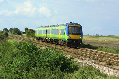 170517 approaches Welney Road LC, Manea on 21/08/2004 whilst forming 1L19 1152 Liverpool Lime Street-Norwich.