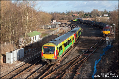 A busy scene at Whitacre Jnct on 08/01/2005 as 170513 forming 1U04 0924 Lincoln Central-Birmingham New Street passes 60080 standing in the loop awaiting to run round 6Z27 1127 Bedworth-Humber consisting of a rake of scruffy Tiphook tanks.