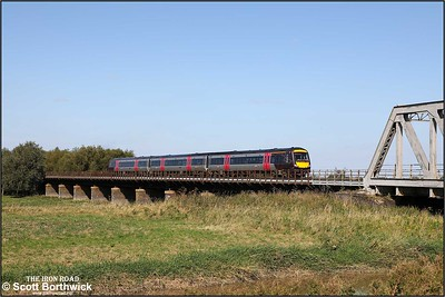 170637 crosses the Welney washes at Pymore whilst forming 1L36 1022 Birmingham New Street-Stansted Airport on 18/09/2019.