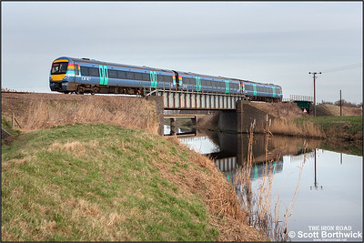 170208 crosses Twenty Foot River at Turves on 22/01/2005 with 1E76 1038 London Liverpool Street-Peterborough.