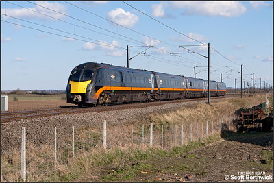 180105 passes Broad Fen Lane, Claypole whilst forming 1A66 1447 Hartlepool-London King's Cross on 03/04/2013.
