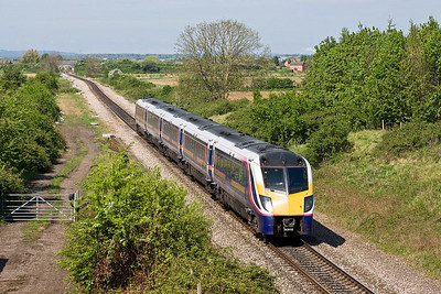 180110 passes Fladbury whilst forming 1F38 1033 Wocester Foregate Street-London Paddington on 26/04/2007.