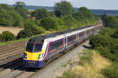 180113 passes Manor Farm, Cholsey whilst forming 1D43 1552 London Paddington-Worcester Shrub Hill on 11/07/2005. The train would be terminated at Didcot due to a suspect package being found on a Virgin Cross Country service at Oxford resulting in the line through Oxford being closed.
