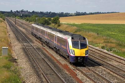 180113 passes Manor Farm, Cholsey whilst forming 1F50 1430 Oxford-London Paddington on 11/07/2005.
