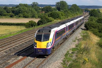 180106 passes Manor farm, Cholsey whilst forming 1G47 1536 London Paddington-Cheltenham Spa on 11/07/2005.