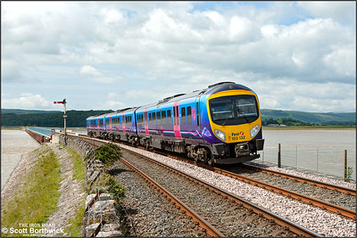 185132 eases off the Kent Viaduct and into Arnside station whilst forming 1N31 1325 Barrow in Furness-Preston on 26/06/2013.