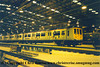 "The first Class 319 4 Car EMU to be painted into the new Thameslink livery was 319 030 which is seen here at Selhurst Depot shortly after being returned from repaint.  In the background can be seen Class 09 Diesel Shunter number 09 025 named ""Victory"".<br /> July 1994"